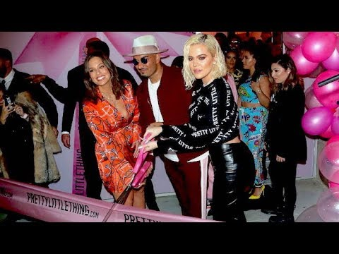 Khloe Kardashian Cuts The Pink Ribbon At PrettyLittleThing Grand Opening With Ashley Graham
