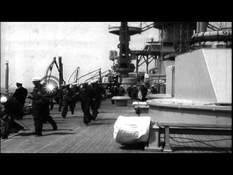 A US fleet including several battleships underway at sea in the United States. HD Stock Footage