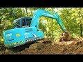 Mini Digger Excavator Kobelco SK75 Working On Road Widening Construction