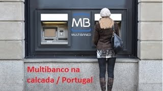 Portugal e o Multibanco  na calçada.