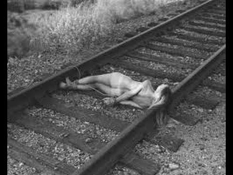 Naked woman train tracks