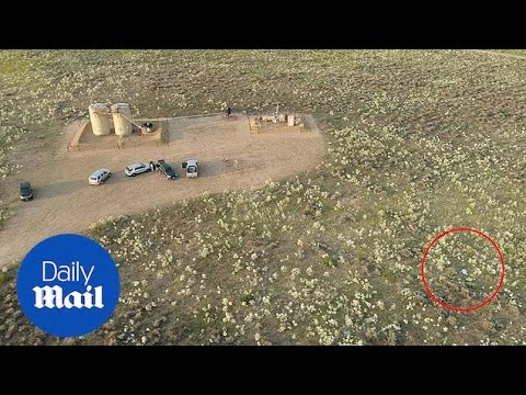 Drone shows body of wife at site where Watts dumped bodies