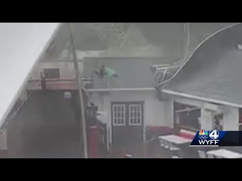 Eric Hunter - Strong Winds Lift Tent While Workers Hold On