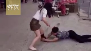 Man tries to win over girlfriend by tearing off her stockings in public