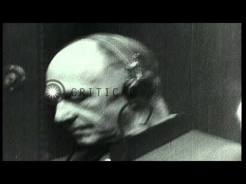 German war prisoners sit with earphones on during war crime trials in Nuremberg, ...HD Stock Footage