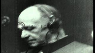 German war prisoners sit with earphones on during war crime trials in Nuremberg, ...HD Stock Footage
