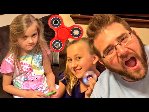 AWESOME FIDGET SPINNER TRICKS AND COMPETITION with DAD (GRIM)