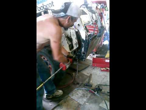Removing the pivot pin bushings on a Bobcat