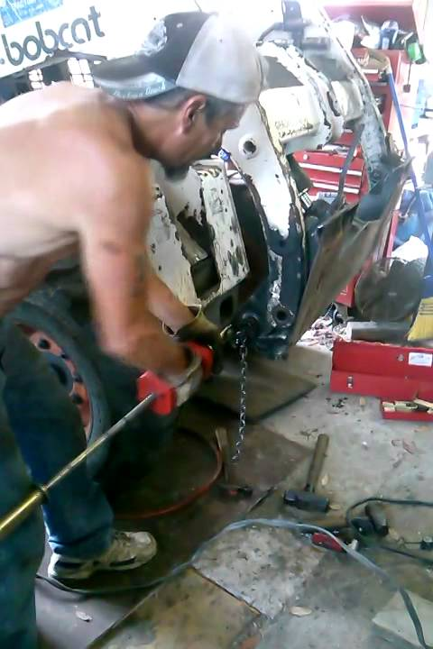 Removing the pivot pin bushings on a Bobcat