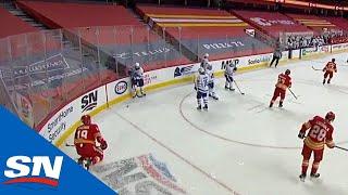 Jake Muzzin Flips Puck At Matthew Tkachuk After Final Horn Causing Scrum Between Leafs & Flames
