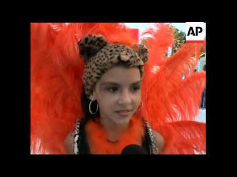 Children parade down the samba avenue as Carnival starts