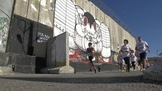 Runners course through Bethlehem in the city