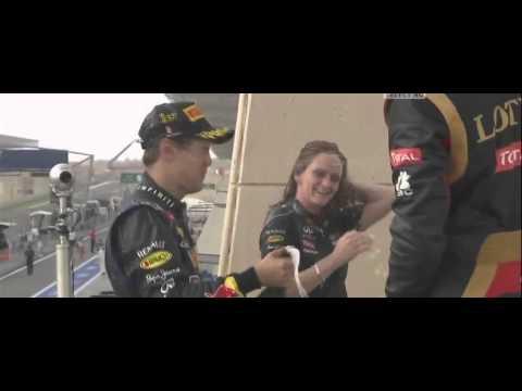 F1 Bahrain GP 2013 - Sebastian Vettel gives to a woman drinking champagne