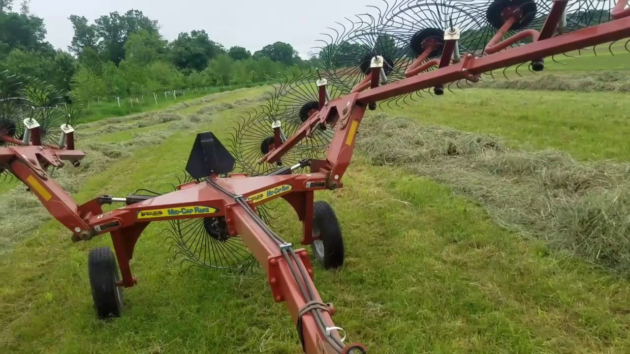 Raking hay with the Pequea Mid-cap rake