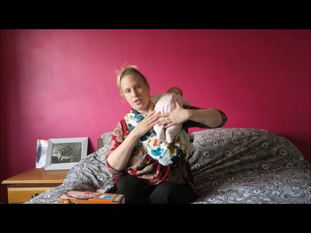 f1dc7217e41 Midwife and Life - Rockin Baby Pouch Carrier Review and How to wear -  Midwife and Life