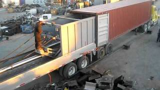 loading metal scrap in containers with machine  video
