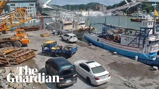 Moment bridge collapses in Taiwan crushing boats and trapping crew