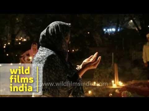 Muslim woman praying at graveyard during Shab-e-barat