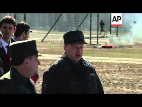 Ukraine's acting president Oleksandr Turchynov on Monday inspected troops training near Kiev to repe