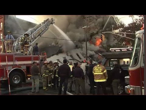 Firefighters battling large fire at buildings in Dover, New Jersey