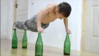 7-Year-Old Child Bodybuilder Giuliano Stroe Does Push-Ups On Glass Bottle (HD)