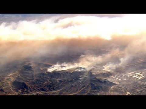 "Santa Ana winds fuel ""out of control"" wildfires"