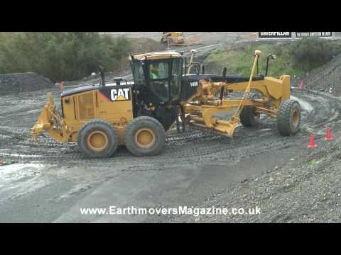 Cat 14M grader test in the rain