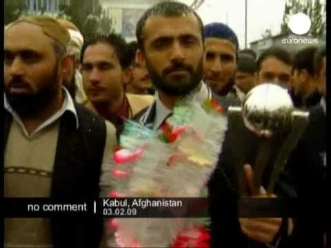 Afghan cricket team return home