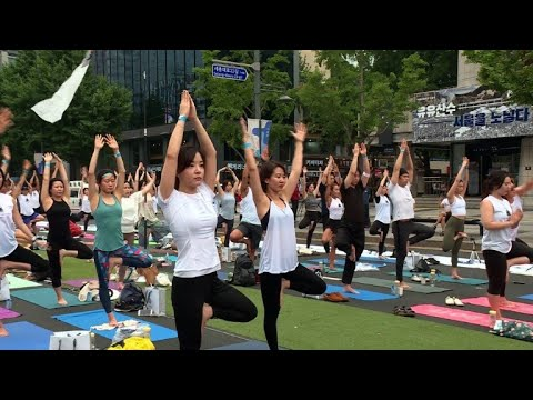 South Koreans stretch in Seoul for International Yoga Day