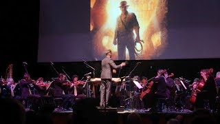 "Brian Tyler Conducts ""Raiders of the Lost Ark March"" in Concert"