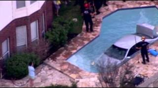 Raw: Car Crashes Into San Antonio Pool