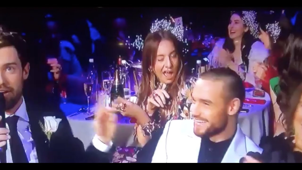 Winner of #BRITs2018 :  The 'drunk' woman behind Cheryl and Liam Payne stole the show