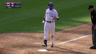 Helton launches a game-tying homer in ninth