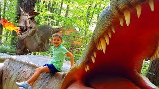 Kids playing at Dino Land. Funny video with Bogdy and Alex