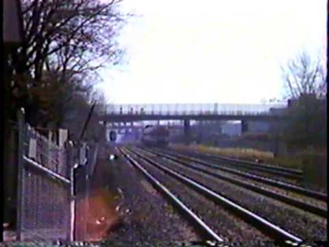 MBTA & Amtrak Trains Passing at Hyde Park MA in March 1988