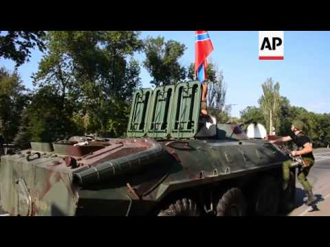 Pro-Russian rebels move APCs from Donetsk to nearby town