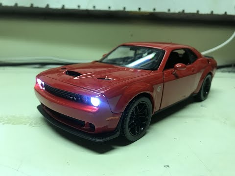 Frank's custom 2018 TorRed Dodge Challenger Hellcat diecast model with working lights
