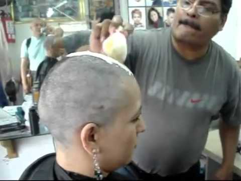 Woman has head shaved by barber thank for