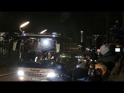 German official buses dozens of migrants to Merkel