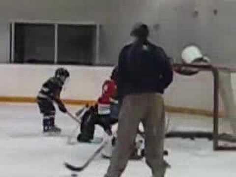 Little kid learning ice hockey 2