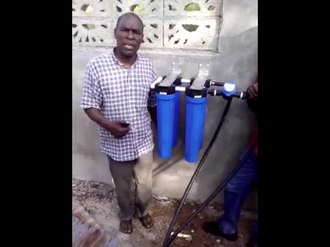 Pastor Brucely Delmas discusses water system in Petit-Goave, Haiti