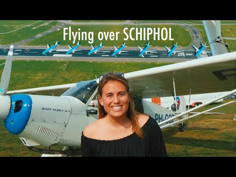Flying over SCHIPHOL AIRPORT and AMSTERDAM in a husky!