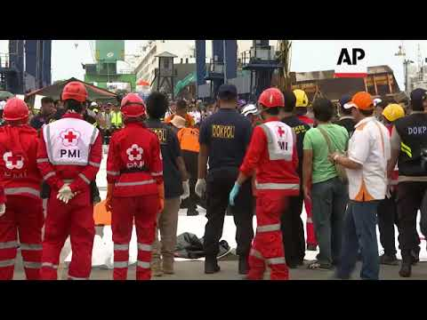 Rescue teams unload body bags from ship at Jakarta's port