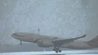 Hainan Airlines Airbus A330 take-off BUD heavy snowfall
