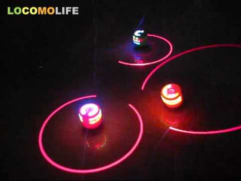 LOCOMO - LED Color Changing Flash Light + Laser Music Sound Spinning Spin Top