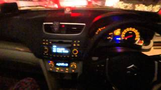 Swift dzire interior in night with reverse parking camera sensors