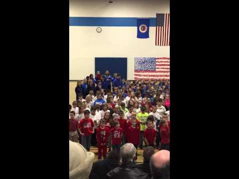 Kasson Mantorville Elementary School Veterans Day celebration singing God bless the USA