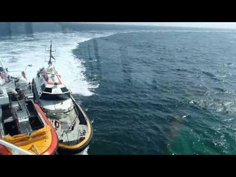 Dutch pilot tender Orion brings some people on board pilot boat Polaris