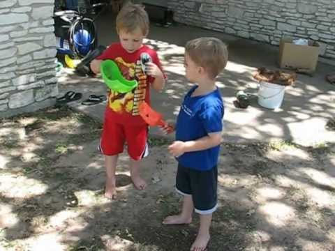 Caleb and Samuel catching frogs