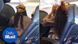 Woman goes BERSERK and swears aggressively on flight